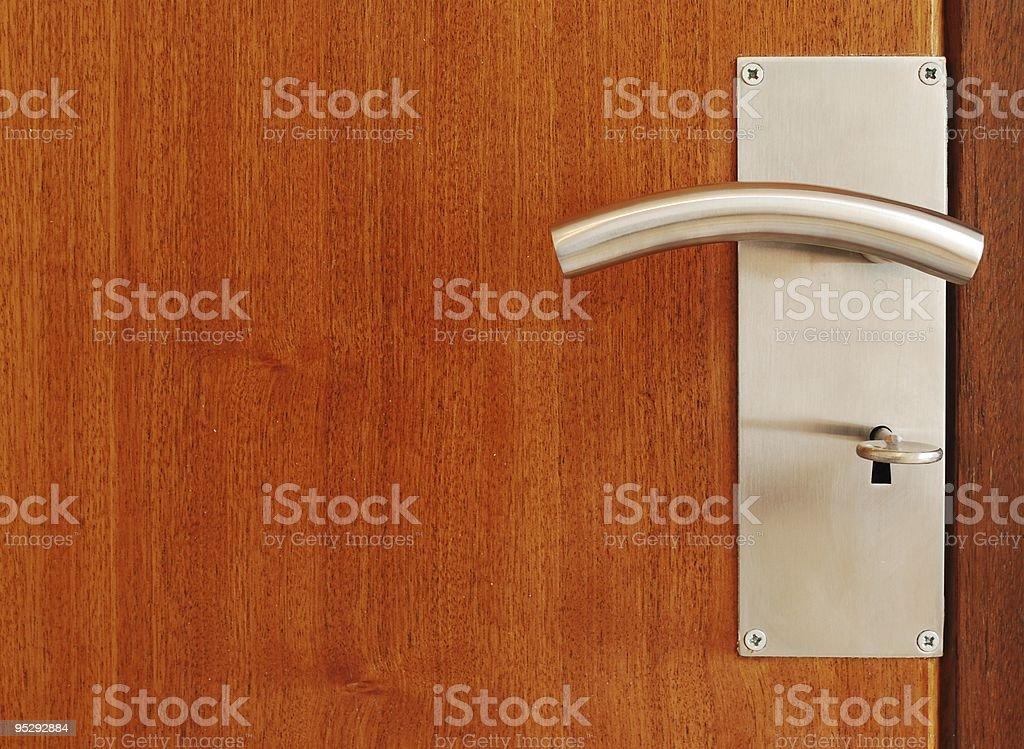 Metallic door handle with key royalty-free stock photo