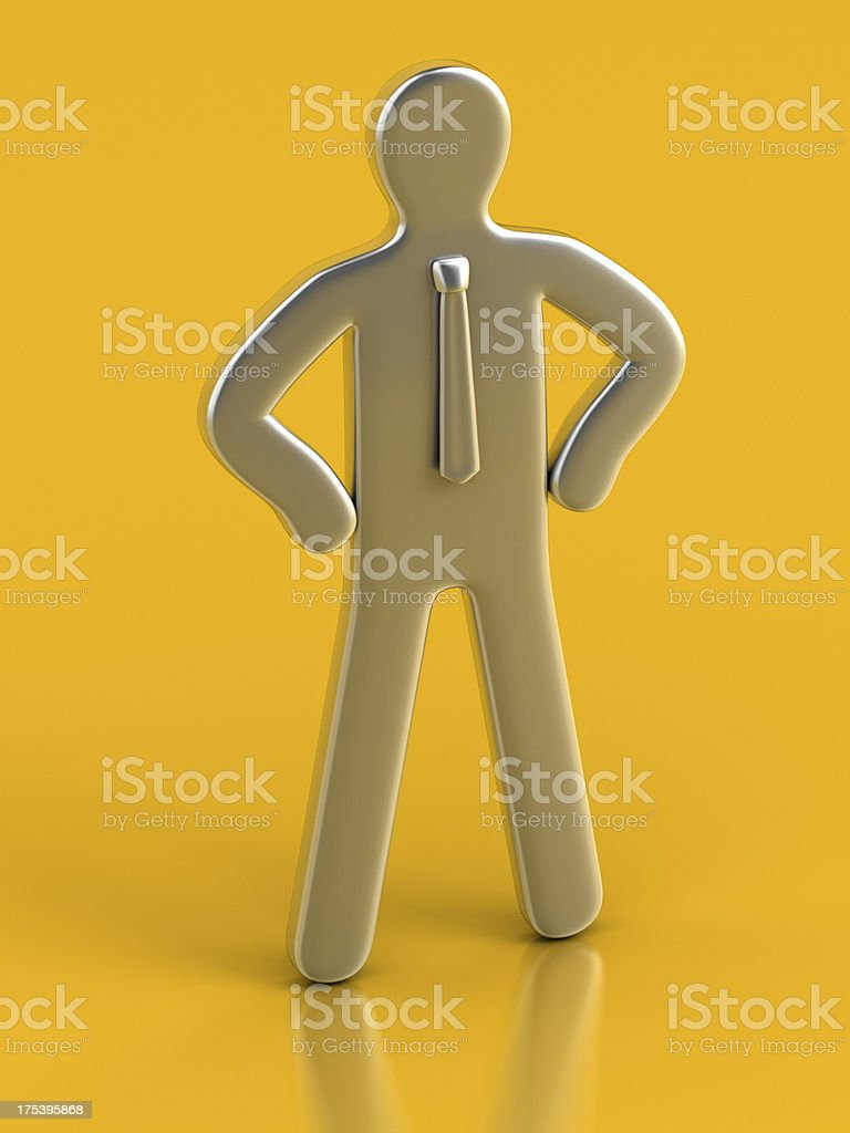 Metallic Figurine against yellow background stock photo