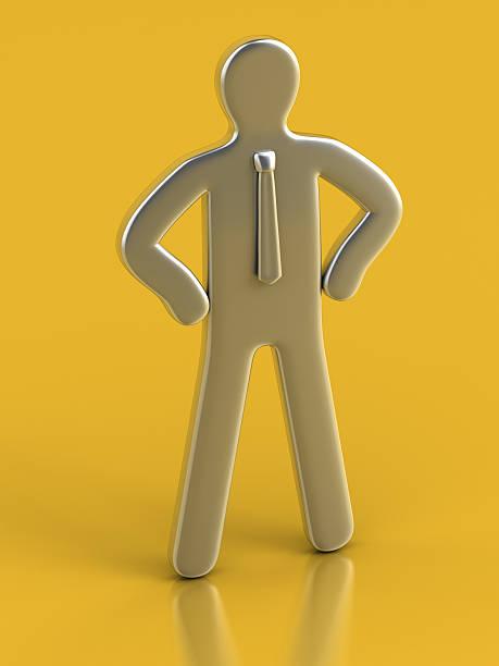 Metallic Figurine against yellow background stock photo