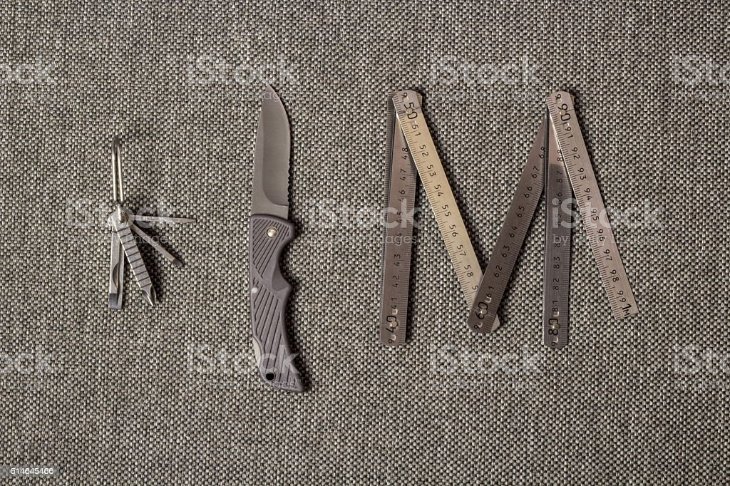 Metallic Folding Ruler, Knife and Multitool stock photo