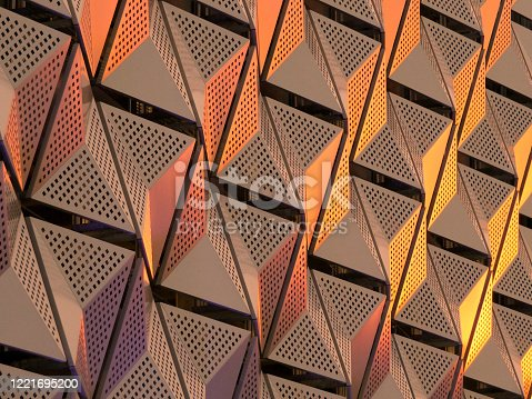 metallic geometric architectural abstract in copper and gold colors