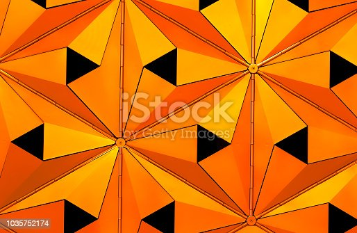 istock metallic geometric cladding or panels in copper and gold colors with repeating angular pattern 1035752174