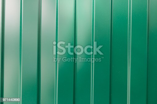 924754302 istock photo Metallic glossy green background from the fence 971440890