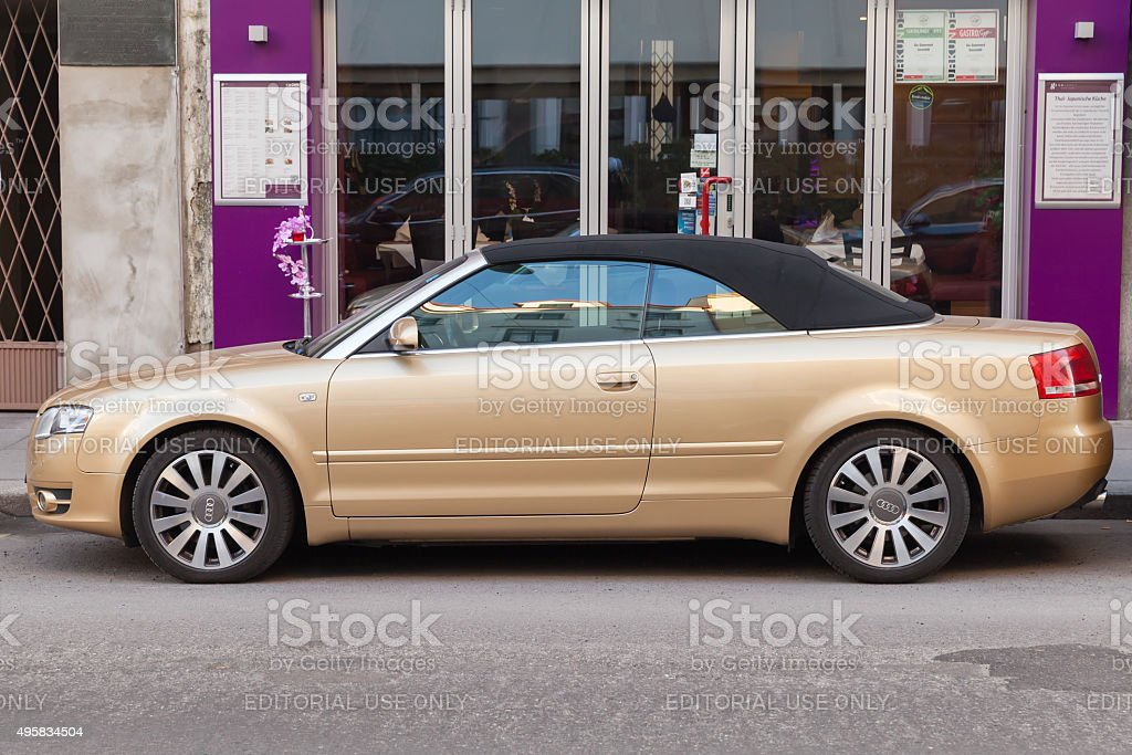 metallic gold audi a4 cabriolet stands on city street stock photo download image now istock https www istockphoto com photo metallic gold audi a4 cabriolet stands on city street gm495834504 78221379