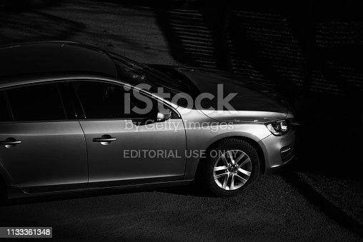 stockholm sweden  february 28 - 2019  unidentified metallic gray car standing parked in parking in sweden - black white photo