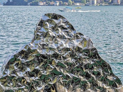 istock Metallic iceberg liquid reflection background 1158145460