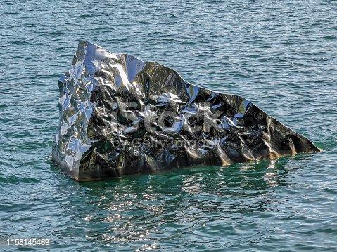 istock Metallic iceberg liquid reflection background 1158145469