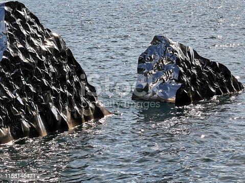 istock Metallic iceberg liquid reflection background 1158145471