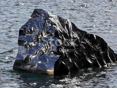 istock Metallic iceberg liquid reflection background 1158145480
