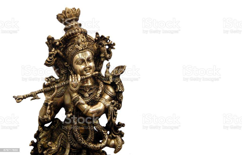 Metallic Idol of Hindu God Sri Krishna stock photo