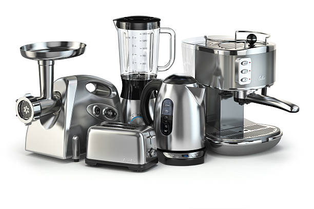 Metallic kitchen appliances. Blender, toaster, coffee machine, m stock photo