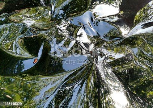 istock Metallic liquid reflection background 1158145329
