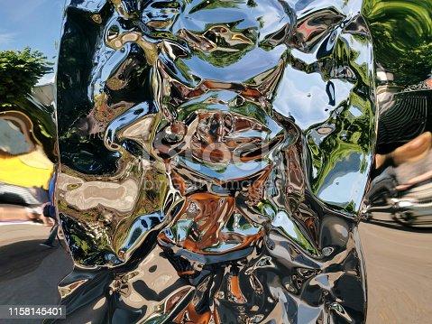 istock Metallic liquid reflection background 1158145401