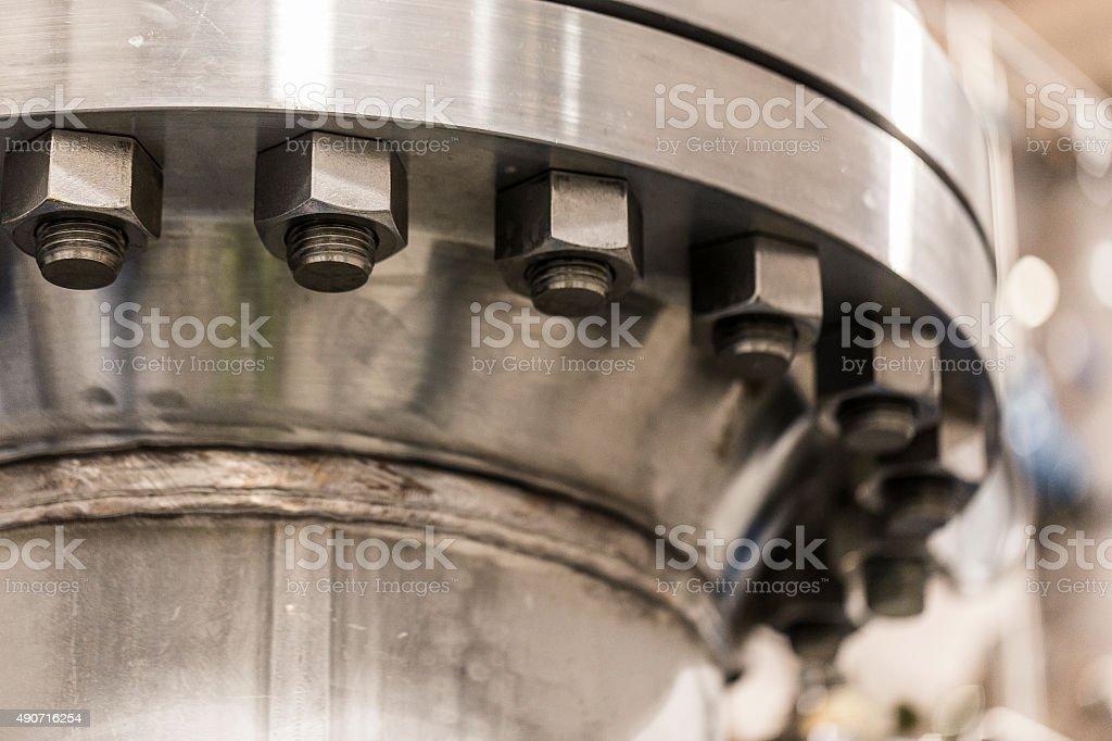 Metallic machinery in brightly lit factory stock photo