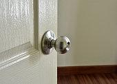 istock Metallic modern door knob on white wooden door. 1031430192
