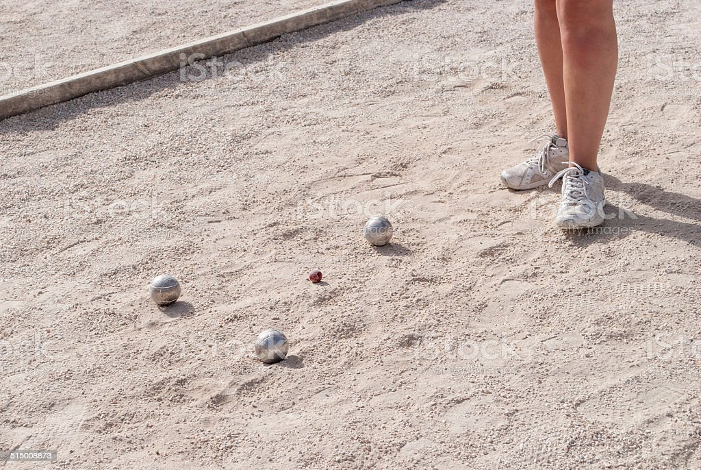Metallic petanque balls on a fine gravel ground stock photo