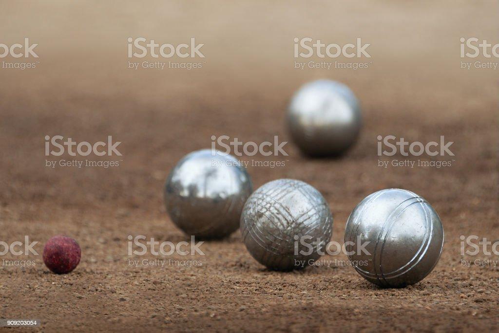 Metallic petanque four balls stock photo