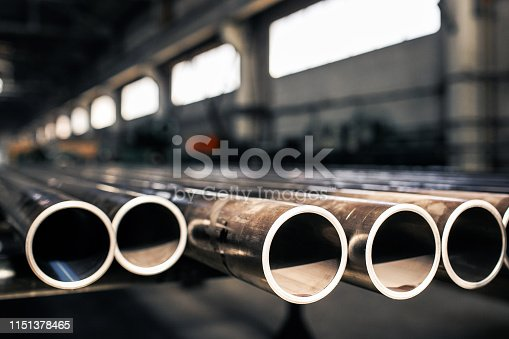 istock Metallic pipes on warehouse, rows of metal pipes on industrial warehouse. Industrial interior, 1151378465