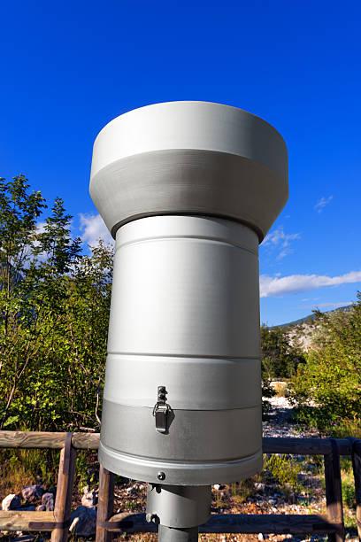 metallic rain gauge in mountain - rain gauge stock photos and pictures