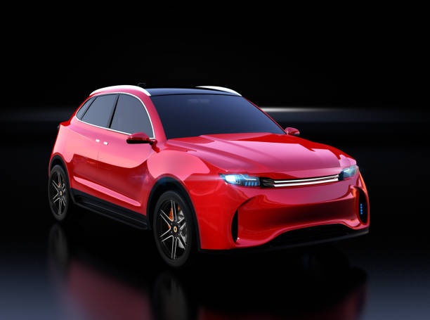 Metallic red Electric SUV concept car isolated on black background stock photo