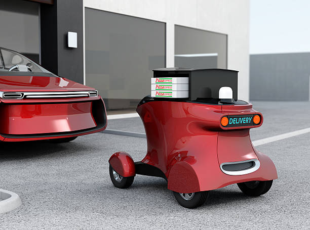 metallic red self-driving delivery robot stopped in front of garage - delivery robot bildbanksfoton och bilder