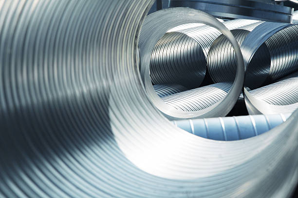 Metallic, ribbed ventilation tubes stock photo