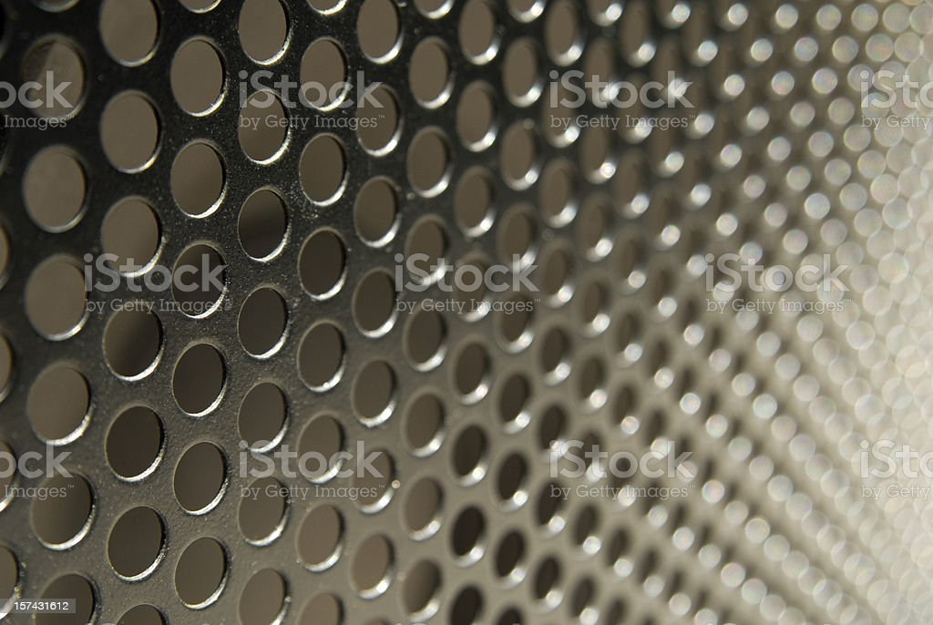Metallic rounded mesh background in macro stock photo