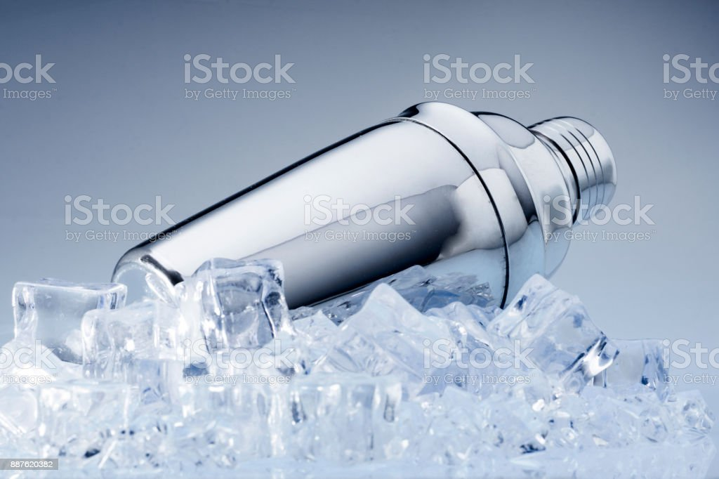 metallic shaker on ice whit grey  background stock photo