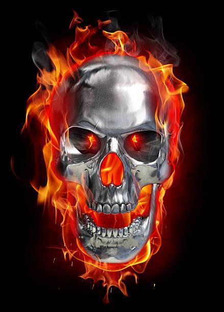 Metallic skull on fire stock photo