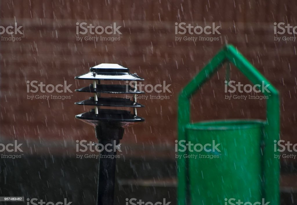 A metallic street lamp shade in the rain unique photo royalty-free stock photo