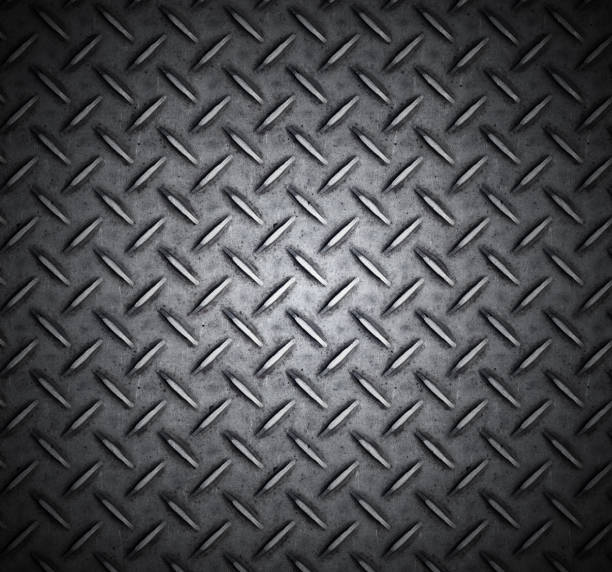 metallic treaded plate with cross design - diamond plate background stock photos and pictures