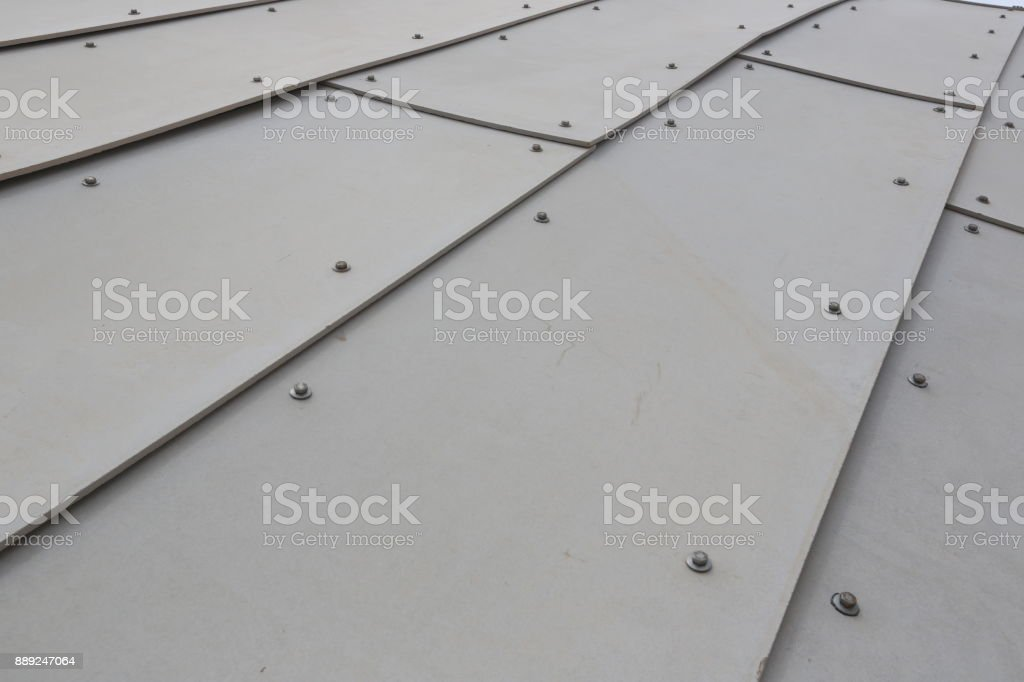 Metallic wall with bolts stock photo