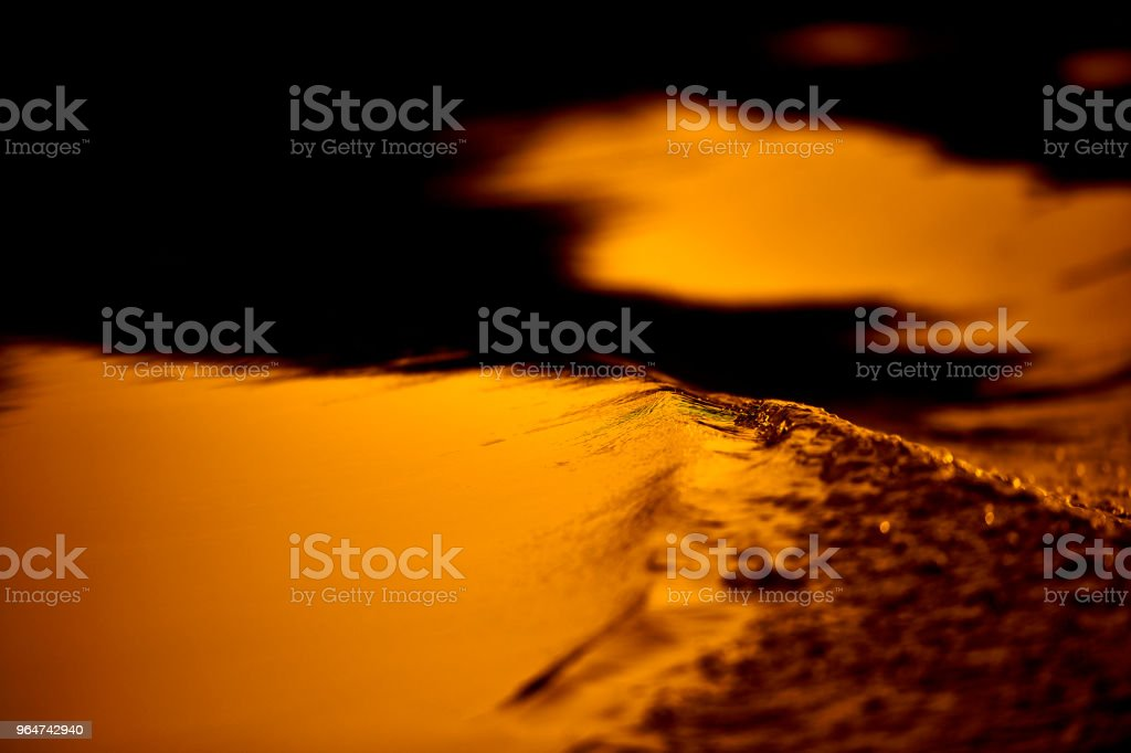 metallic water in the sunset royalty-free stock photo