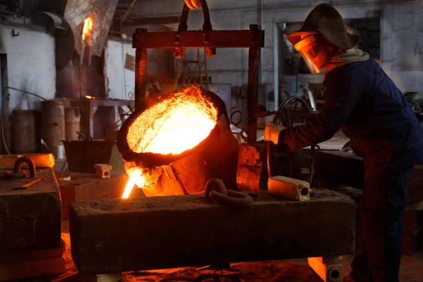 metallurgical plant, hot metal casting - metallurgy stock photos and pictures