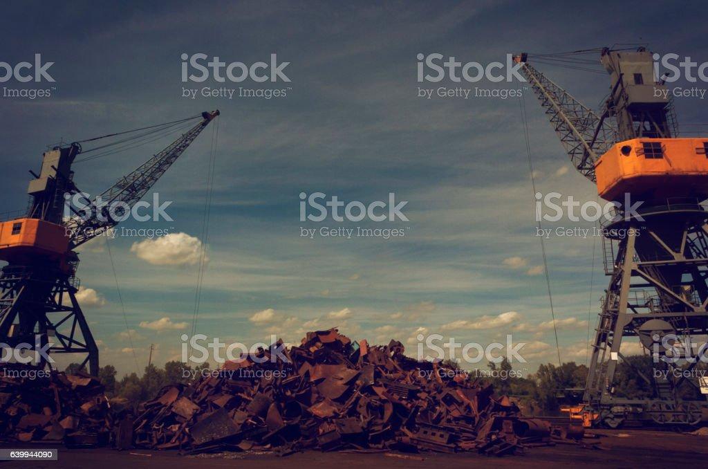 Metals recycling cranes stock photo