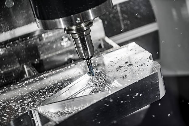 Metalworking CNC milling machine. Metalworking CNC milling machine. Cutting metal modern processing technology. Small depth of field. Warning - authentic shooting in challenging conditions. A little bit grain and maybe blurred. metalwork stock pictures, royalty-free photos & images