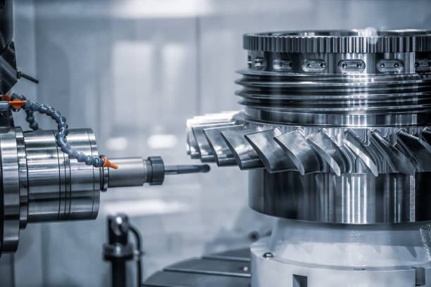 Metalworking CNC milling machine. Metalworking CNC milling machine. Cutting metal modern processing technology. Small depth of field. Warning - authentic shooting in challenging conditions. A little bit grain and maybe blurred. metal worker stock pictures, royalty-free photos & images