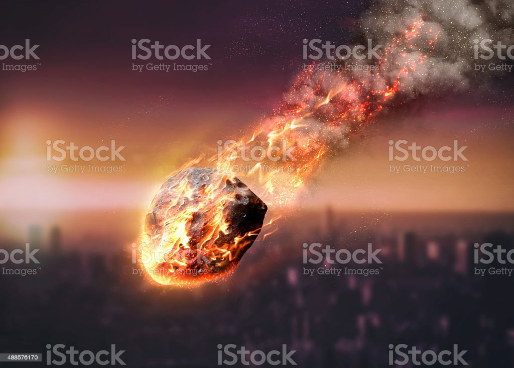 Meteor glowing as it enters the Earth's atmosphere stock photo