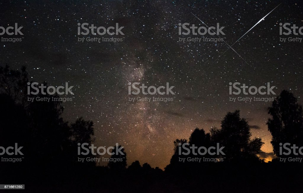 Meteor in the starry sky stock photo