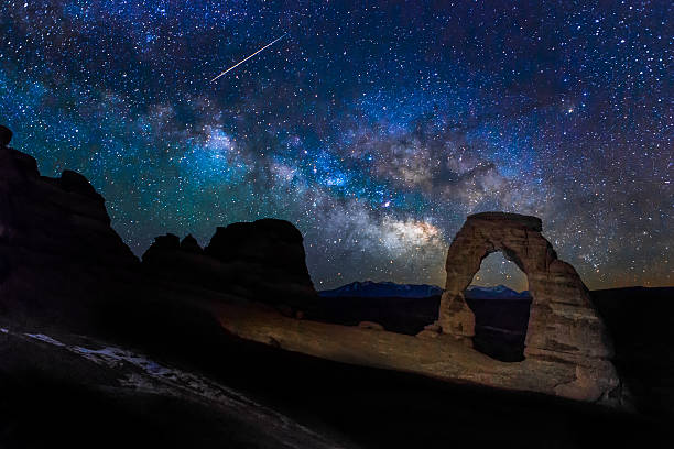"Meteor, Milky way and the Delicate Arch ""Meteor, Milky way and the Delicate Arch"" delicate arch stock pictures, royalty-free photos & images"