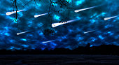 Meteor shower in the night sky in a park with long explorer. The photo is generated from a camera photo using image processing software. It consist 17 layers