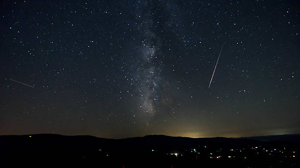 meteor shower shooting through the milky way and stars - shooting stars stock photos and pictures