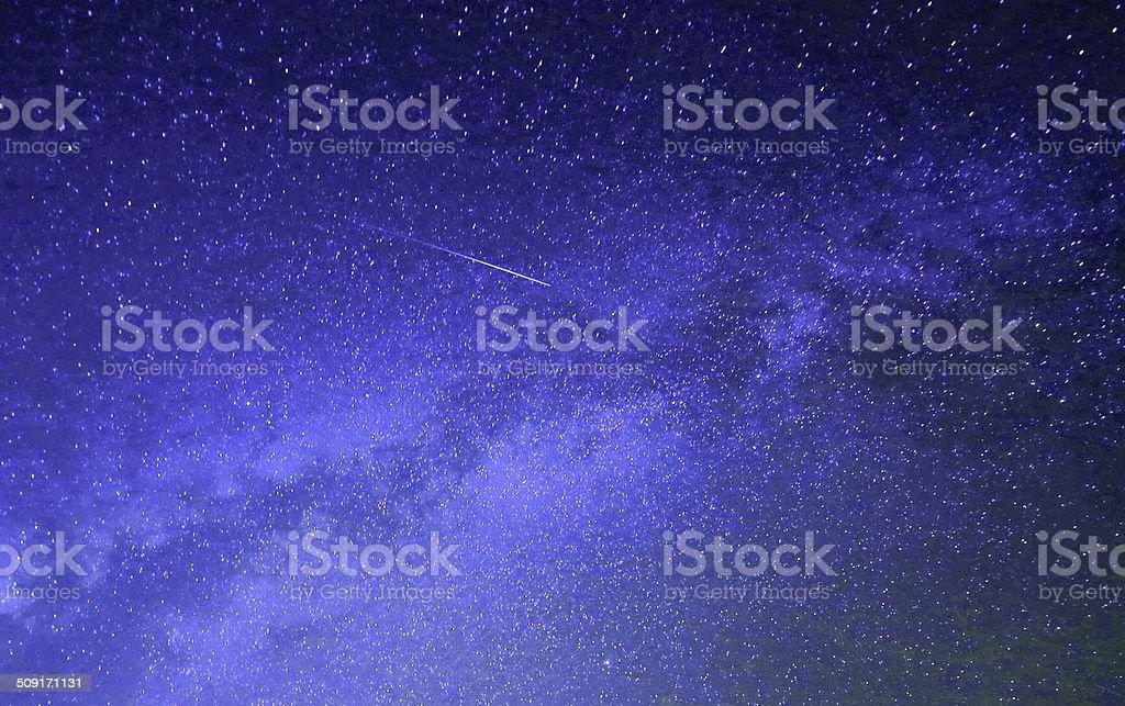 Meteor through the Milky Way stock photo