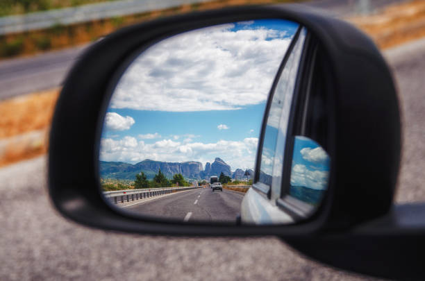 Meteora and Thessaly valley seen on the rearview mirror, Greece stock photo