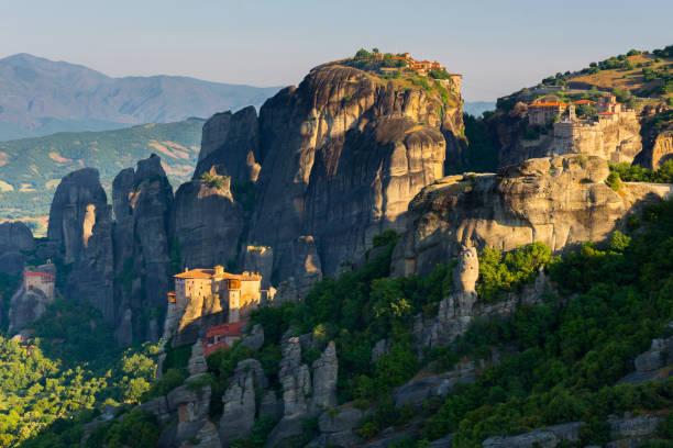 Meteora monasteries at sunrise, Greece stock photo