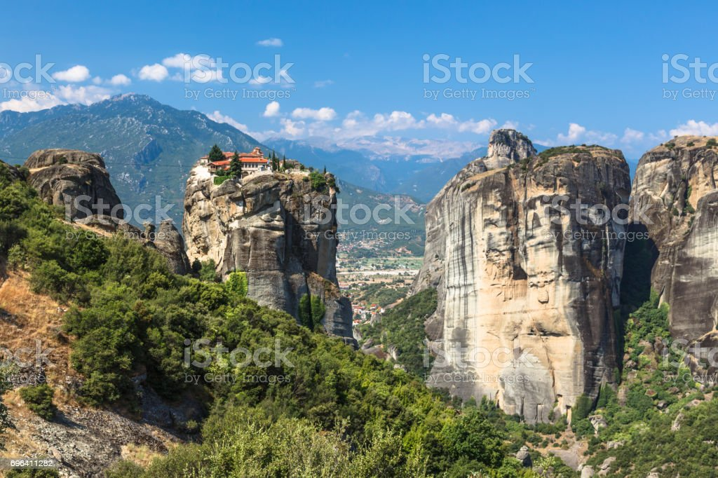 Meteora monasteries. Beautiful view on the Holy Monastery of Great Meteofo placed on the edge of high rock at sunrise, Kastraki, Greece. stock photo