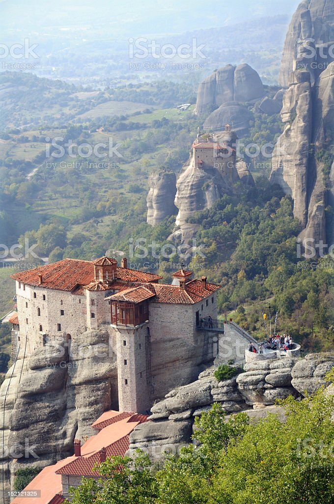 Meteora standing alone on the edge of a cliff stock photo