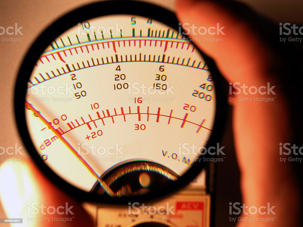 Meter Face Through Magnifier royalty-free stock photo
