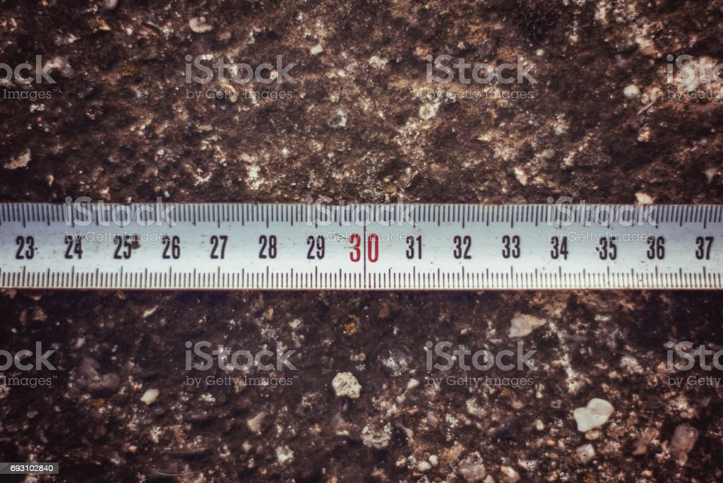 Meter isolated on stone background stock photo