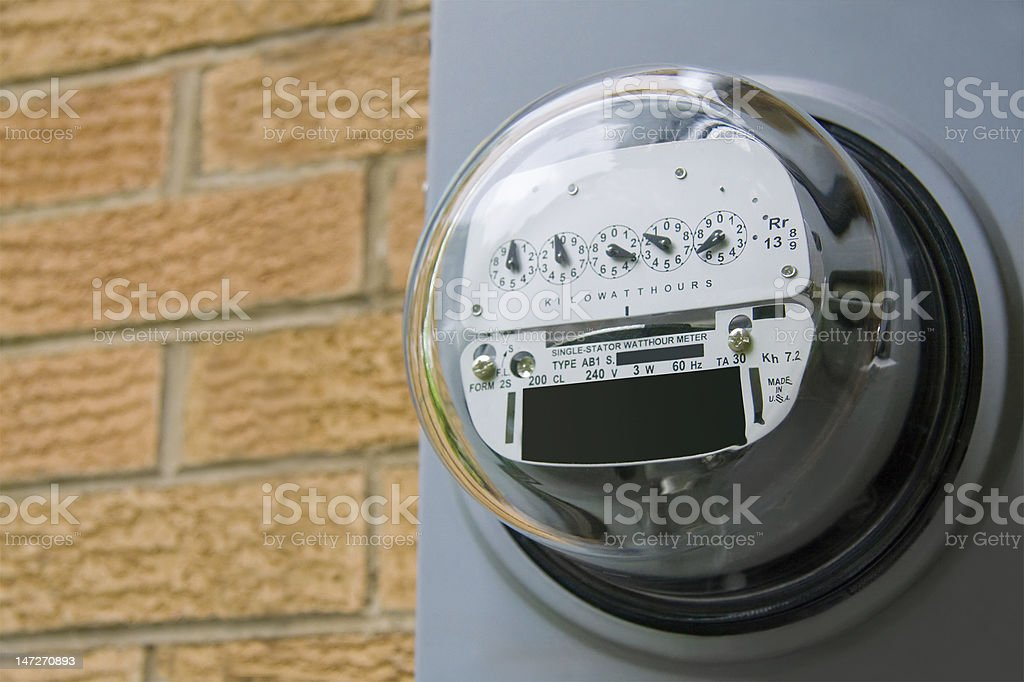 Meter on a building to read the electricity stock photo